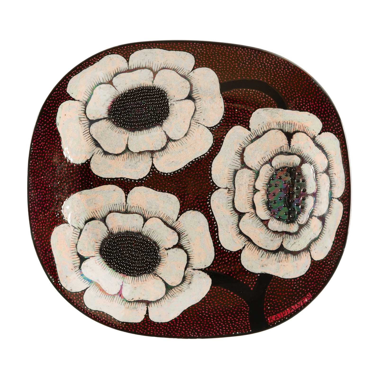 A wall mounted dish, decorated with large flowers