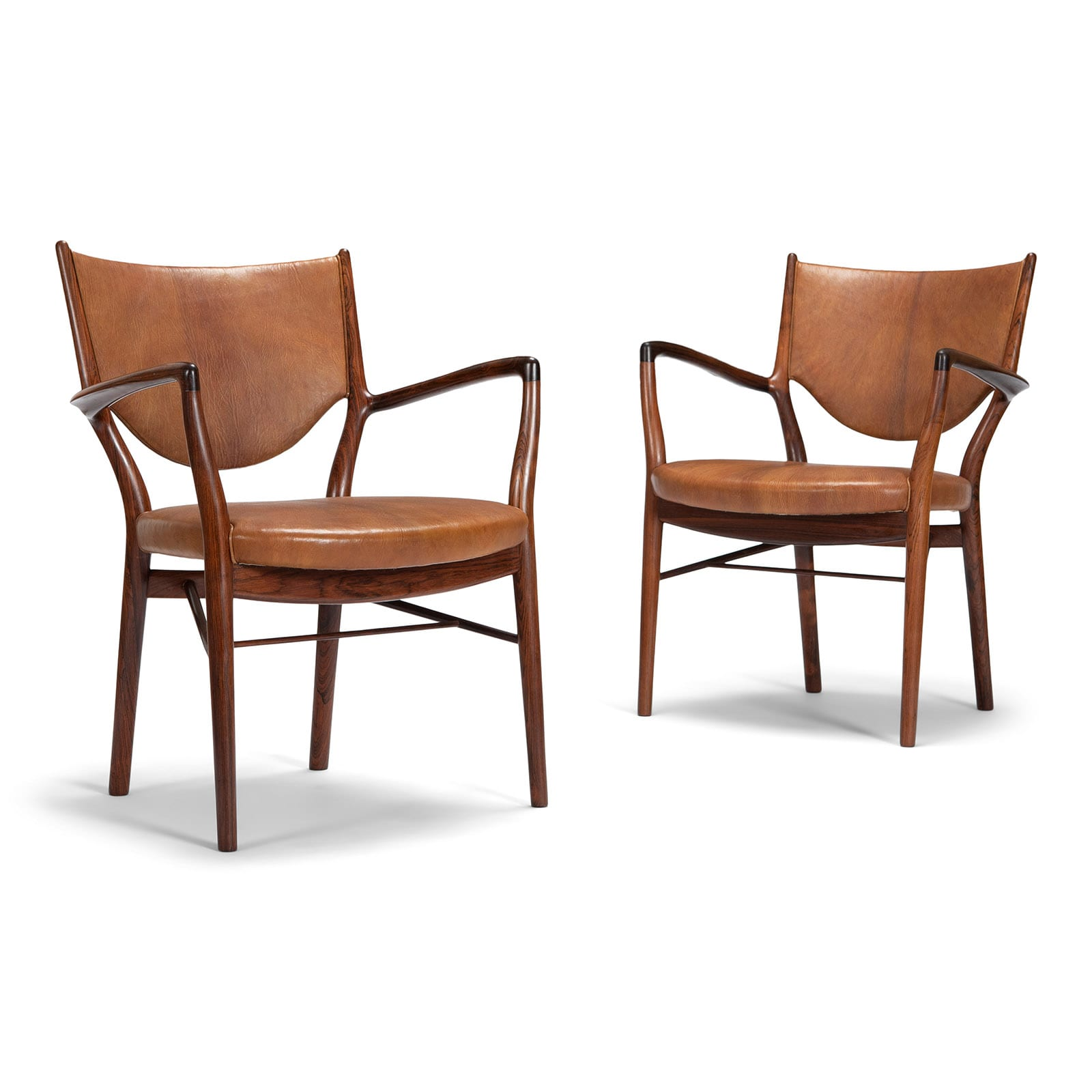 A pair of NV46 armchairs