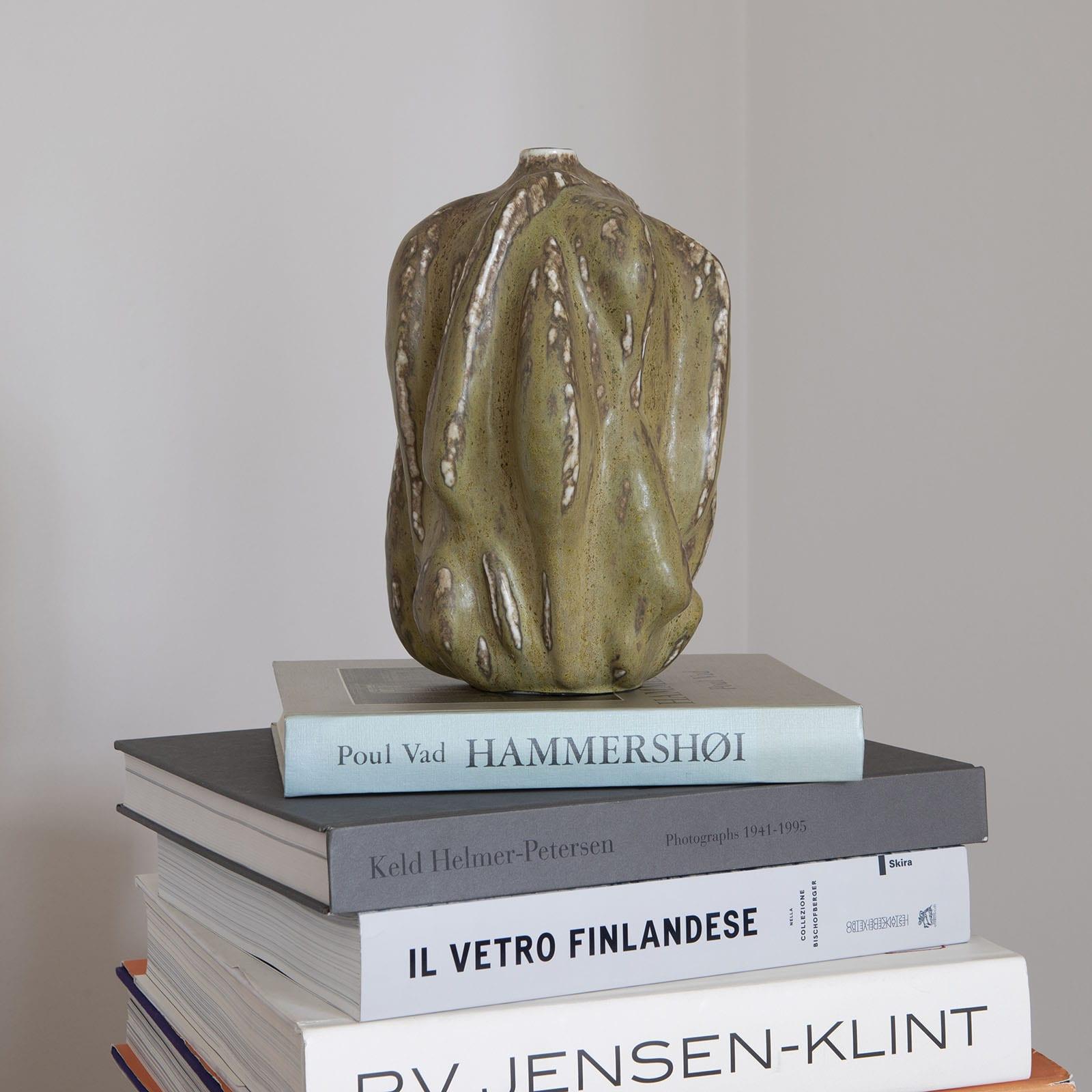 A green glazed vase